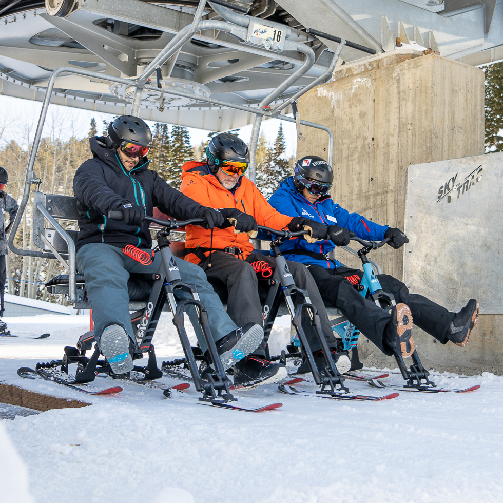 SNO-GO Riders Loading a Chairlift